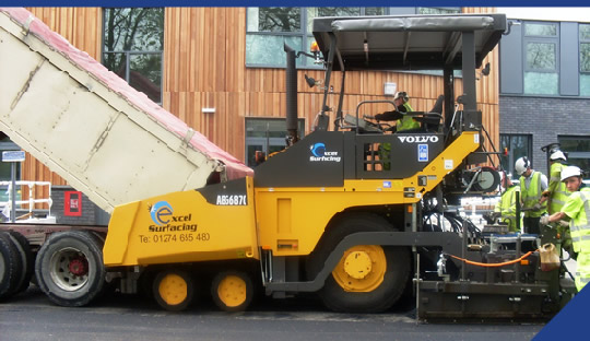 Excel Surfacing Macadam Surfacing and Planing - Our new Volvo 6870 paving machine
